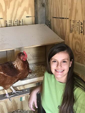 Kadie and one of her hens
